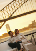 Couple enjoying Sydney Harbour Bridget at sunset