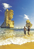 Couple walking along the shore near the Twelve Apo