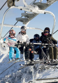 Family enjoying their views on the chairlift