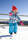Small child playing and having fun in the snow