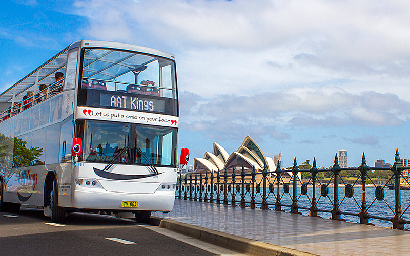 Double Deckers driving around iconic Sydney Harbour with Opera House views