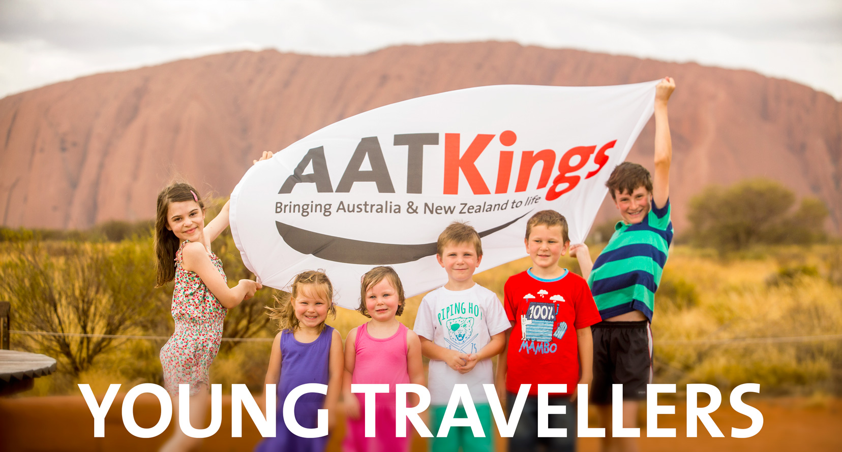 Children and young travellers at Uluru viewing area with AAT Kings