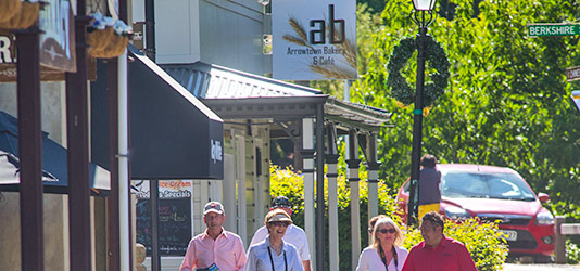 Guests and Travel Director walking to Arrowtown Bakery