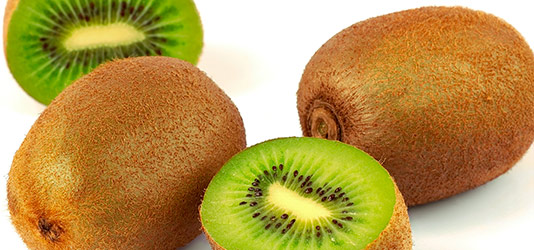 Whole and freshly cut kiwi fruit